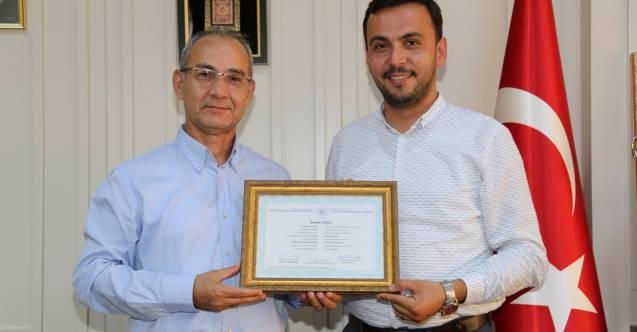 ALKÜ'den Toklu'ya yüksek lisans diploması...